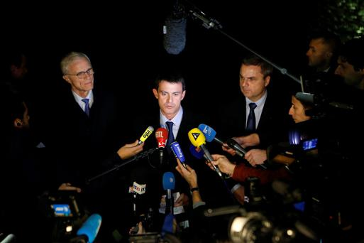 French Interior Minister Manuel Valls (C) and Christian Flaesch (center R), director of the Paris' judiciary police, attend a news conference at the headquarters of the Paris police