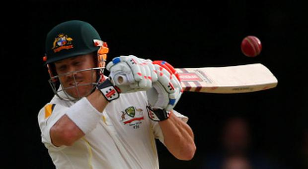 Australia's David Warner plays a shot during the second day's play of the first Ashes cricket test match against England in Brisbane