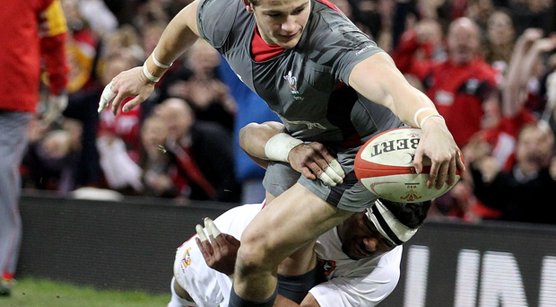 Wales Hallam Amos is tackled by Tonga's Siale Piutau during the Dove Men Series match at the Millennium Stadium tonight