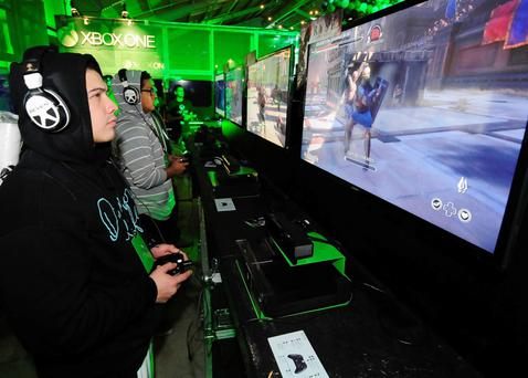 Xbox fans play the latest games during the Xbox One fan celebration and launch party in Los Angeles on Thursday