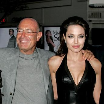 Angelina Jolie with producer Arnon Milchan at the premiere of the movie 'Mr & Mrs Smith' in Los Angeles