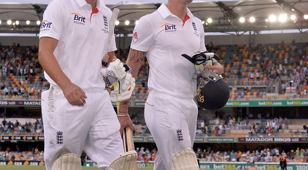 England's Alastair Cook (left) and Kevin Pietersen (right) look-on as the players leave the field at the close of play during day three of the first Ashes Test at The Gabba, Brisbane
