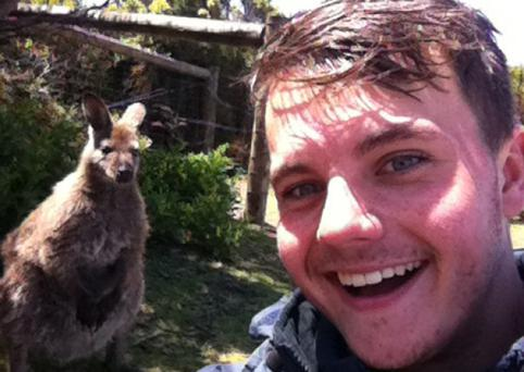 Joe Stuttle with a wallaby while in Tasmania