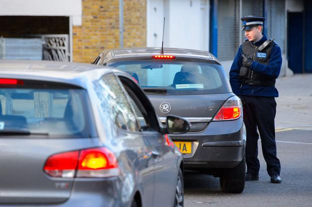 A PCSO speaks to a driver near flats in Brixton, south London.