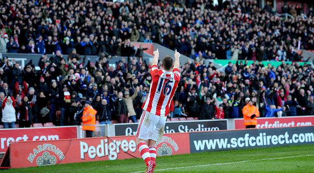 Stoke City's Charlie Adam celebrates scoring his side's first goal
