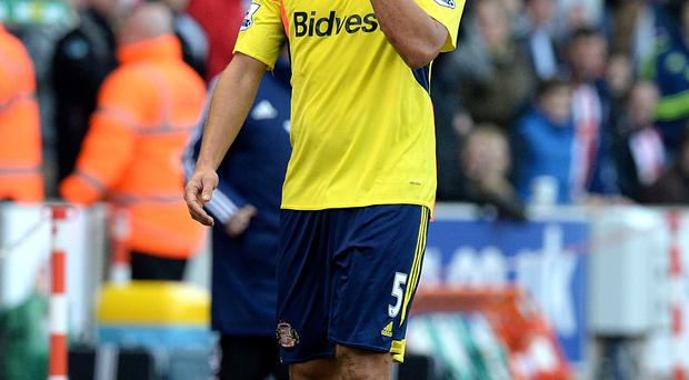 Sunderland's Wes Brown leaves the pitch after being shown a red card for a challenge on Stoke City's Charlie Adam