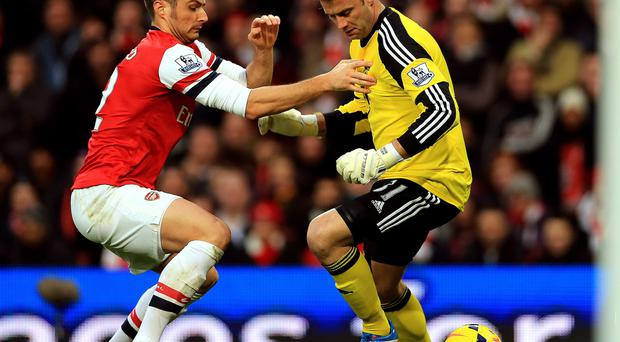 Arsenal's Olivier Giroud (left) and Southampton's Artur Boruc battle for the ball in the lead-up to Arsenal's first goal