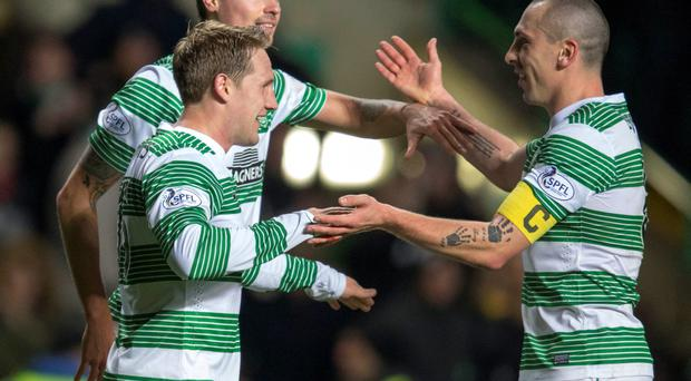 Celtic's Kris Commons (left) celebrates scoring his second goal with fellow goal scorer Derk Boerrigter and man of the match Scott Brown