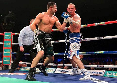 Carl Froch (left) punches George Groves before referee Howard Foster stepped in the end the WBA and IBF Super Middleweight Title fight.