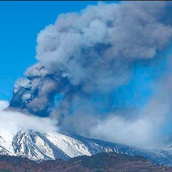 Smoke billows from the Mount Etna, Europe's tallest active volcano