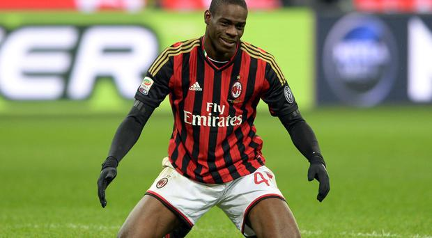 Mario Balotelli of AC Milan looks dejected during the Serie A match between AC Milan and Genoa CFC at Stadio Giuseppe Meazza on Saturday