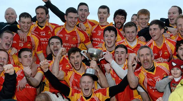 Castlebar Mitchels players and supporters celebrate at the end of the game