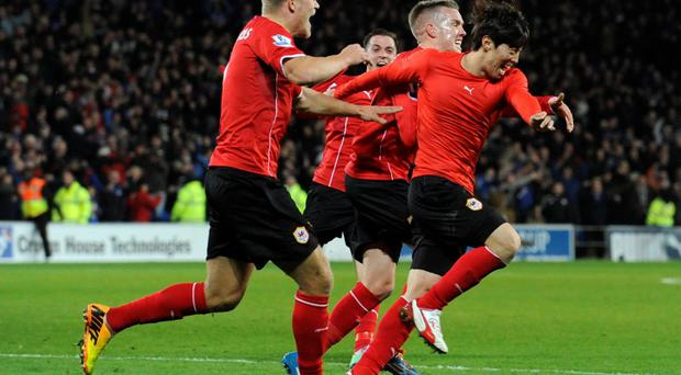 Cardiff City's Kim Bo-Kyung (C) scores his late, late equaliser