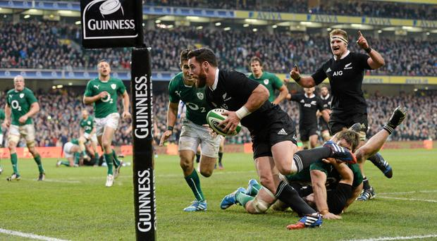 New Zealand's Ryan Crotty goes over for his side's final try despite the tackle of Ireland's Conor Murray.