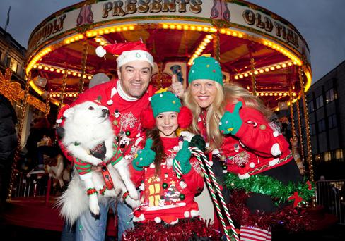 Mark and Lucky Frances with their daughter, 9 year old Sarah, from Trim, Co Meath, winners of the Geansai Nollaig Day 2013 on O'Connell Street
