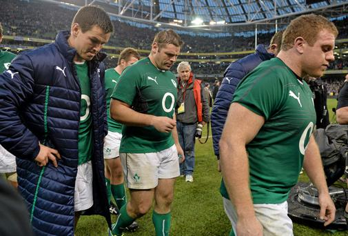 Ireland's Jonathan Sexton, left, Mike Ross, centre, and Sean Cronin leave the pitch after the game