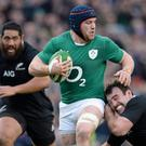 Sean O'Brien is tackled by Andrew Hore, New Zealand