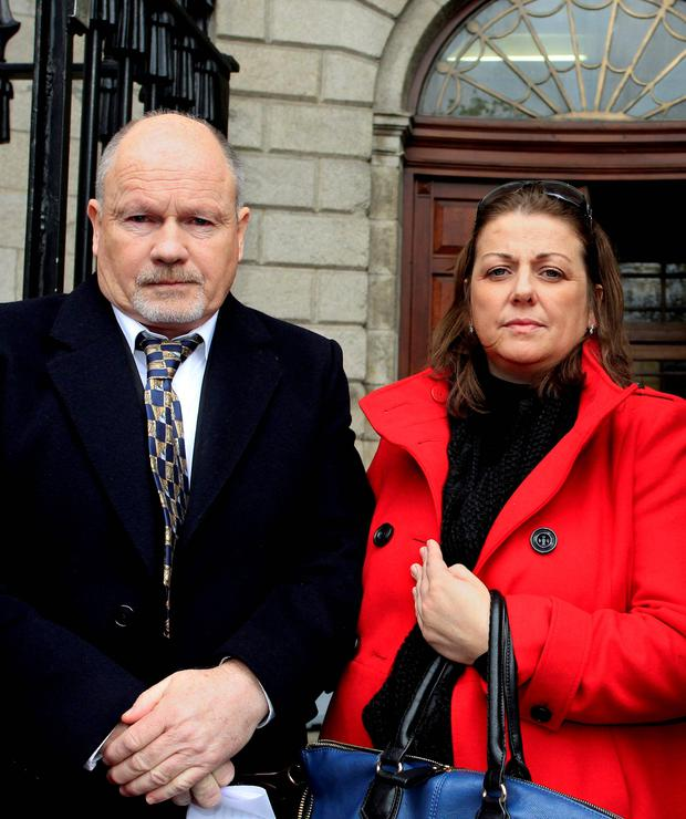 Kevin and Mary Conroy, parents of cerebral palsy victim Roisin, outside the High Court today where they were awarded a €2.6million settlement on behalf of their daughter. Caption: Courtpix.