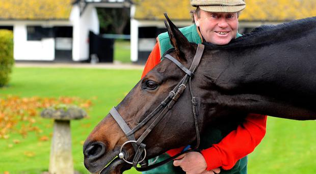 Nicky Henderson with Long Run at Seven Barrows Stables on November 26