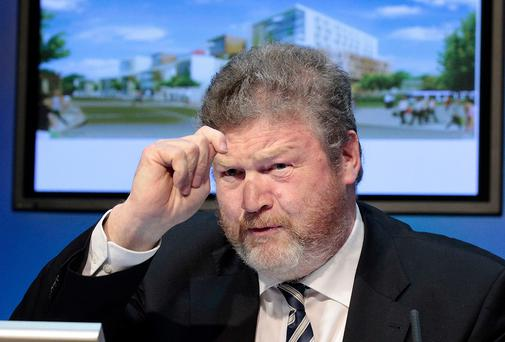 Questions are being raised over the control Health Minister James Reilly has over things, according to John Downing