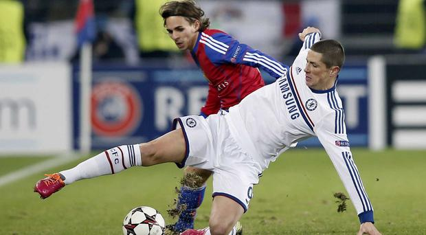 Chelsea's Fernando Torres, foreground, fights for the ball against FC Basel's Kay Voser, during their Champions League group E soccer match, at St. Jakob-Park stadium in Basel, Switzerland, Tuesday, Nov. 26, 2013. (AP Photo/Keystone, Peter Klaunzer)