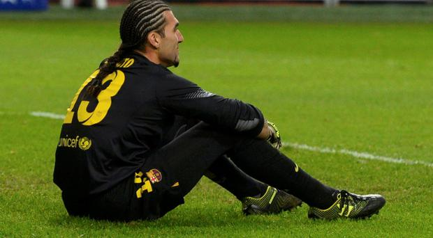 Barcelona's goalkeeper Jose Manuel Pinto reacts during a Champions League group H soccer match against Ajax Amsterdam at Amsterdam Arena