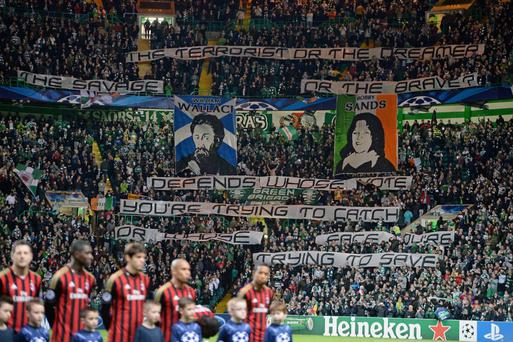 Celtic supporters wave banners comparing Scottish independence fighter William Wallace with IRA hunger striker Bobby Sands during the UEFA Champions League Group H match between Celtic and AC Milan at Celtic Park Stadium last night
