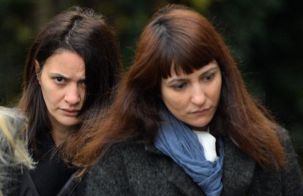 Italian sisters Elisabetta (L) and Francesca Grillo arrive at Isleworth Crown Court in west London today