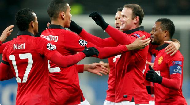 Manchester United's Nani, Chris Smalling, Ryan Giggs, Wayne Rooney and Patrice Evra (L-R) celebrate after Bayer Leverkusen's Emir Spahic scored an own-goal during their Champions League Group A soccer match