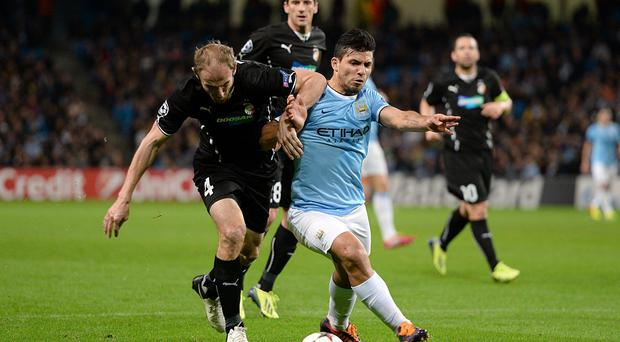 Manchester City's Sergio Aguero (right) and Plzen's Roman Hubnik during the UEFA Champions League match