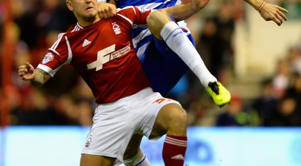 Kaspars Gorkss of Reading battles with Simon Cox of Nottingham Forest during the Sky Bet Championship match tonight