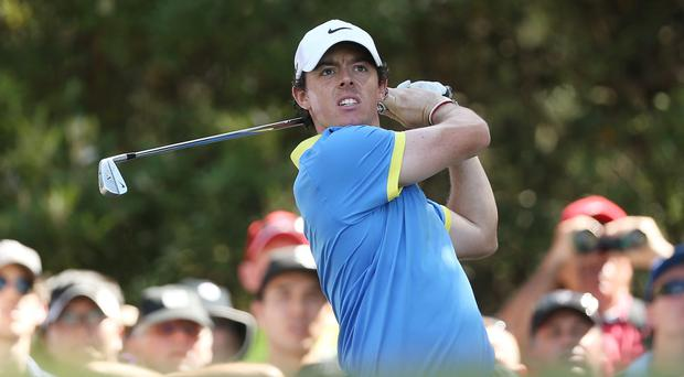 SYDNEY, AUSTRALIA - NOVEMBER 30: Rory McIlroy of Northern Ireland plays a tee-shot shot during day three of the Australian Open at Royal Sydney Golf Club on November 30, 2013 in Sydney, Australia. (Photo by Mark Metcalfe/Getty Images)