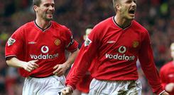 Manchester United's David Beckham (R) celebrates scoring with captain Roy Keane (L) during their United days