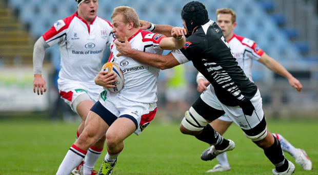 Luke Marshall, Ulster, is tackled by Marco Bortolami