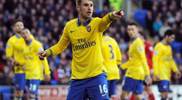 Arsenal's Aaron Ramsey in action against Cardiff City today