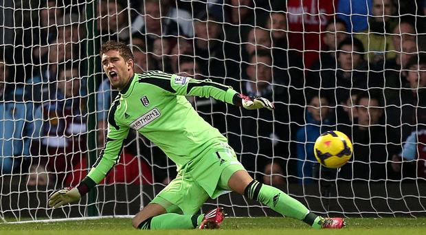 Fulham goalkeeper Maarten Stekelenburg is left wrong-footed as West Ham United's Mohamed Diame scores the Hammers first goal