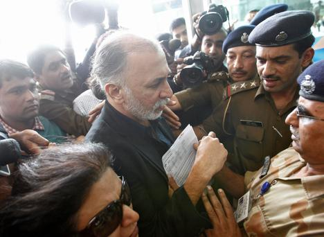 Tarun Tejpal, the 50-year-old founder and editor-in-chief of India's leading investigative magazine Tehelka, is asked to produce his travel papers by Central Industrial Security Force (CISF) officers upon his arrival at the airport on his way to Goa, in New Delhi