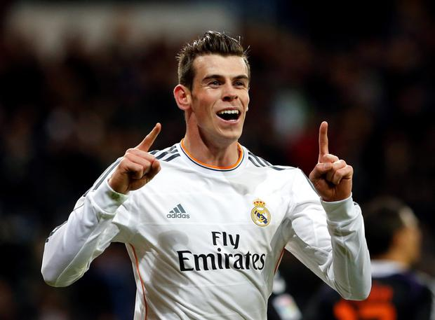 Real Madrid's Gareth Bale celebrates his goal against Real Valladolid during their Spanish First Division soccer match at Santiago Bernabeu stadium in Madrid last night