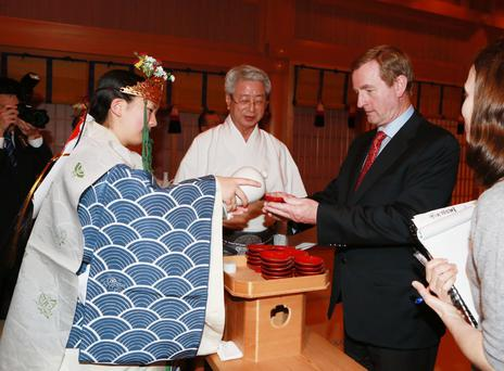 Taoiseach is offered a ceremonial drink of sake(Japanese rice wine) while on visit to Meiji Shurine.