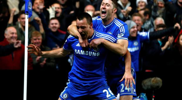 Chelsea's John Terry (L) celebrates with Gary Cahill after scoring a goal against Southampton