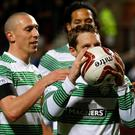 Celtic's Kris Commons celebrates his third goal against Heart of Midlothian during their Scottish Cup fourth round soccer match at Tynecastle stadium, Edinburgh