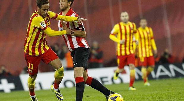 Barcelona's Neymar (L) is challenged by Athletic Bilbao's Carlos Gurpegui (2nd L) during their Spanish first division soccer match at San Mames stadium in Bilbao