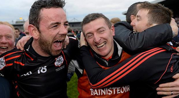James Hickey, Mount Leinster Rangers, celebrates with manager Tom Mullally, after the game