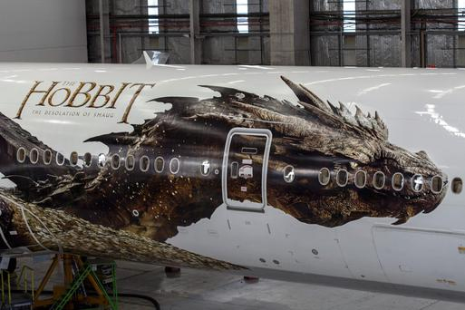 An image of the dragon Smaug from Peter Jackson's Hobbit trilogy, is shown on the side of an Air New Zealand plane in Auckland, New Zealand