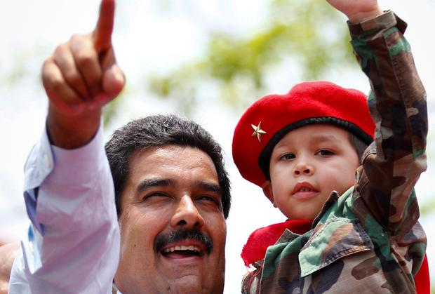 Venezuela'spresident Nicolas Maduro carries a child during a campaign rally in the state of Barinas earlier this year.
