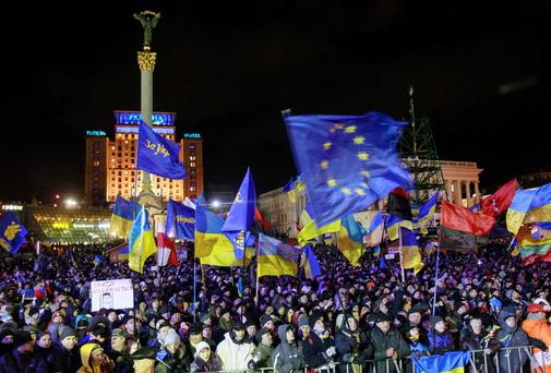 People supporting EU integration attend a rally in Kiev