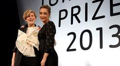 Actress Saoirse Ronan with Laure Prouvost after announcing her as the winner of this year's Turner Prize at the Venue in Derry