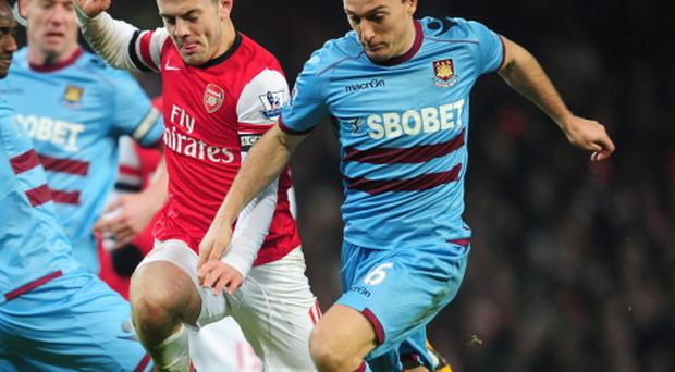 Mark Noble (right) in action for West Ham against Arsenal
