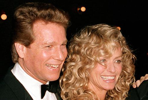 Ryan O'Neal and Farrah Fawcett in 1989.
