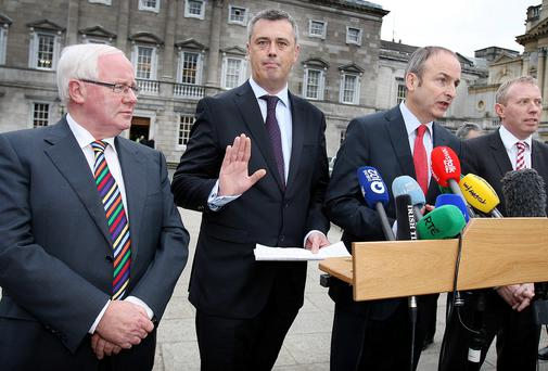 Fianna Fail leader Micheal Martin welcomes Colm Keaveney into the party at Leinster House yesterday, as Brendan Smith, left, and Timmy Dooley, right, look on